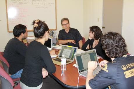 Professor Steven Athanases (center) talks with his undergraduate research team.