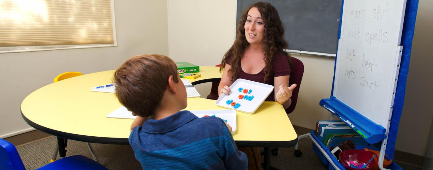 Tutor helps a student with reading services