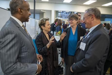 Gary May (left), Alice Waters (middle left), Lauren Lindstrom (middle right), and  Ralph Hexter (right) discussing the new Alice Waters Institute for Edible Education at UC Davis