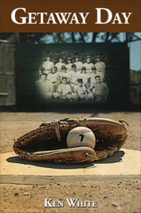 Baseball and glove resting on the ground