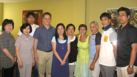 Our faculty share a moment with the Korean teachers.