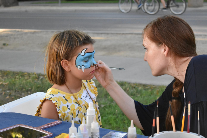 Child gets face painted