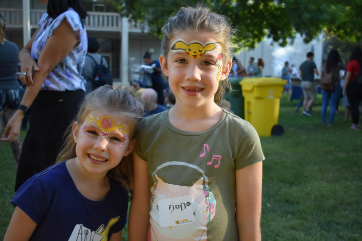 Children with face painting pose for camera