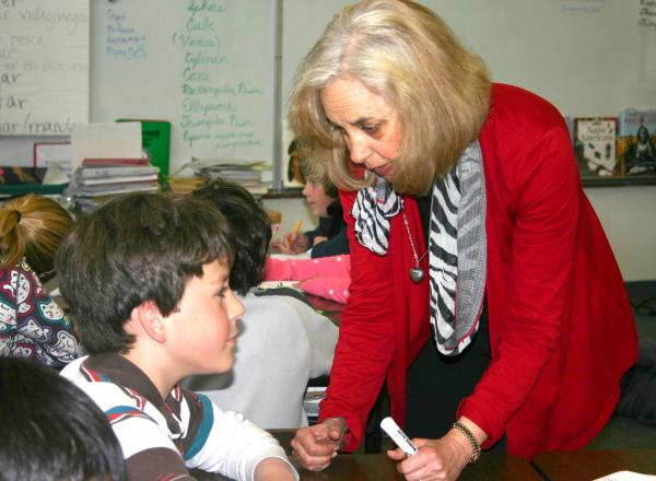 Teacher Sue Davis helping a student in her classroom